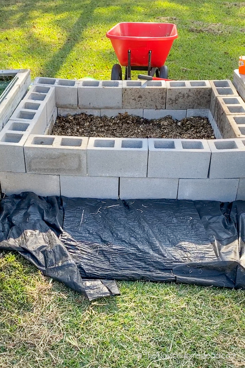 cinderblock garden filled with mulch from home compost pile
